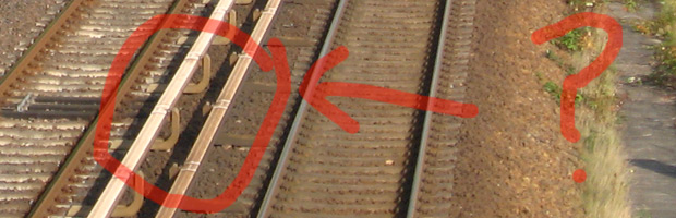 A third rail is normally a structure on stands right next to the rails.